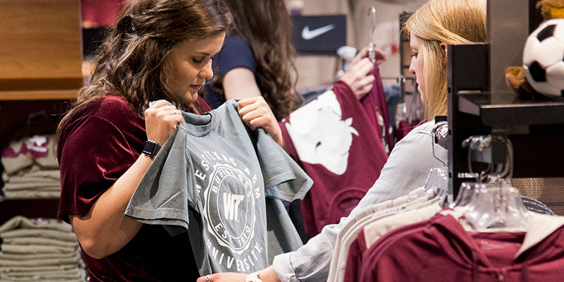two students shopping for WTAMU shirts