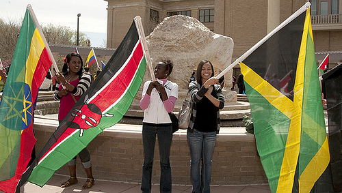 Interational Students representing their home country with a flag celebration in the Pedestrian Mall.