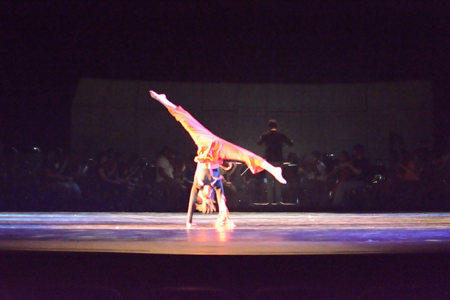 Dancer doing handstand during Firebird dance.