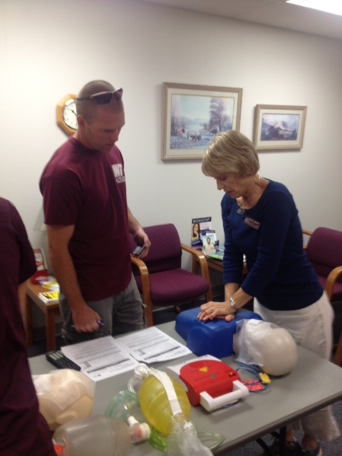 Kevin Wright instructing Wendy Hearn, FNP how to perform CPR