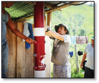 Student working in jungle village on water filter