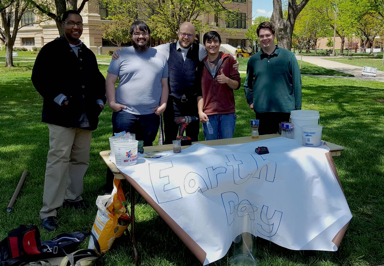 Students and professors outside together on Earth Day