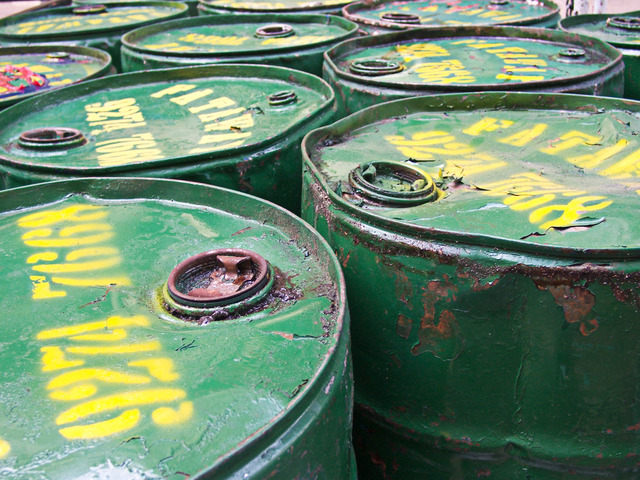 Tops of old green hazardous waste drums