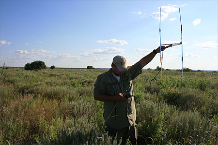 A WTAMU Professor raking a reading on the high plains