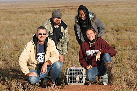 WTAMU Students posing with professor in a field
