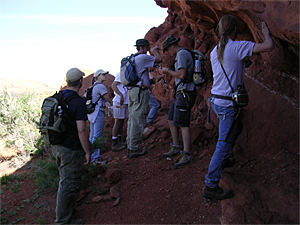 Explaining rock formations to a group of students