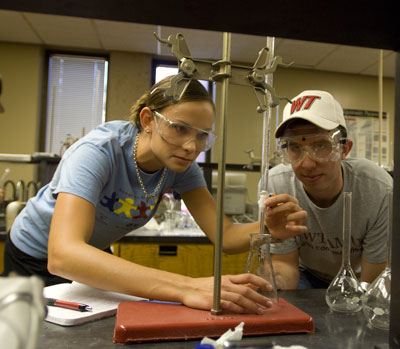 Two researchers conducting experiment