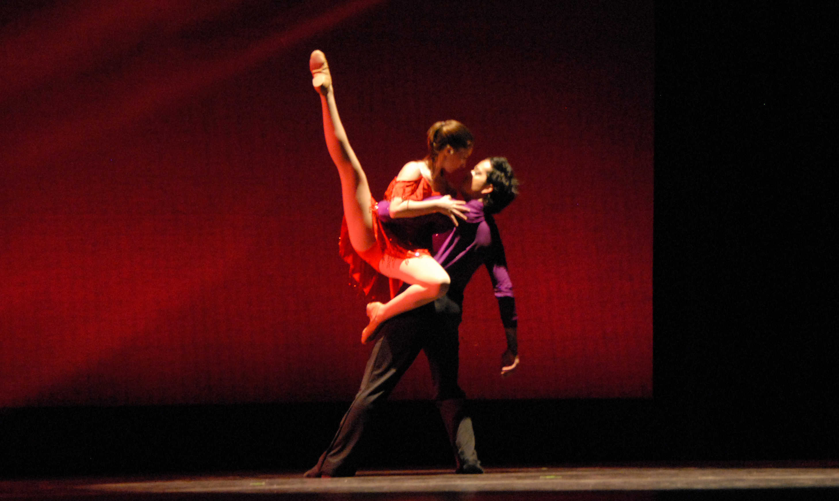 Two dancers tango on stage