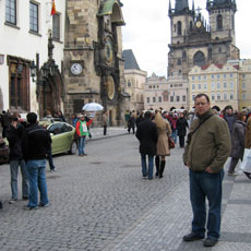 Picture of professor Scott Frish standing in street filled with people.
