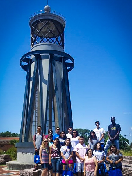 UB Students posing in front of lighthouse