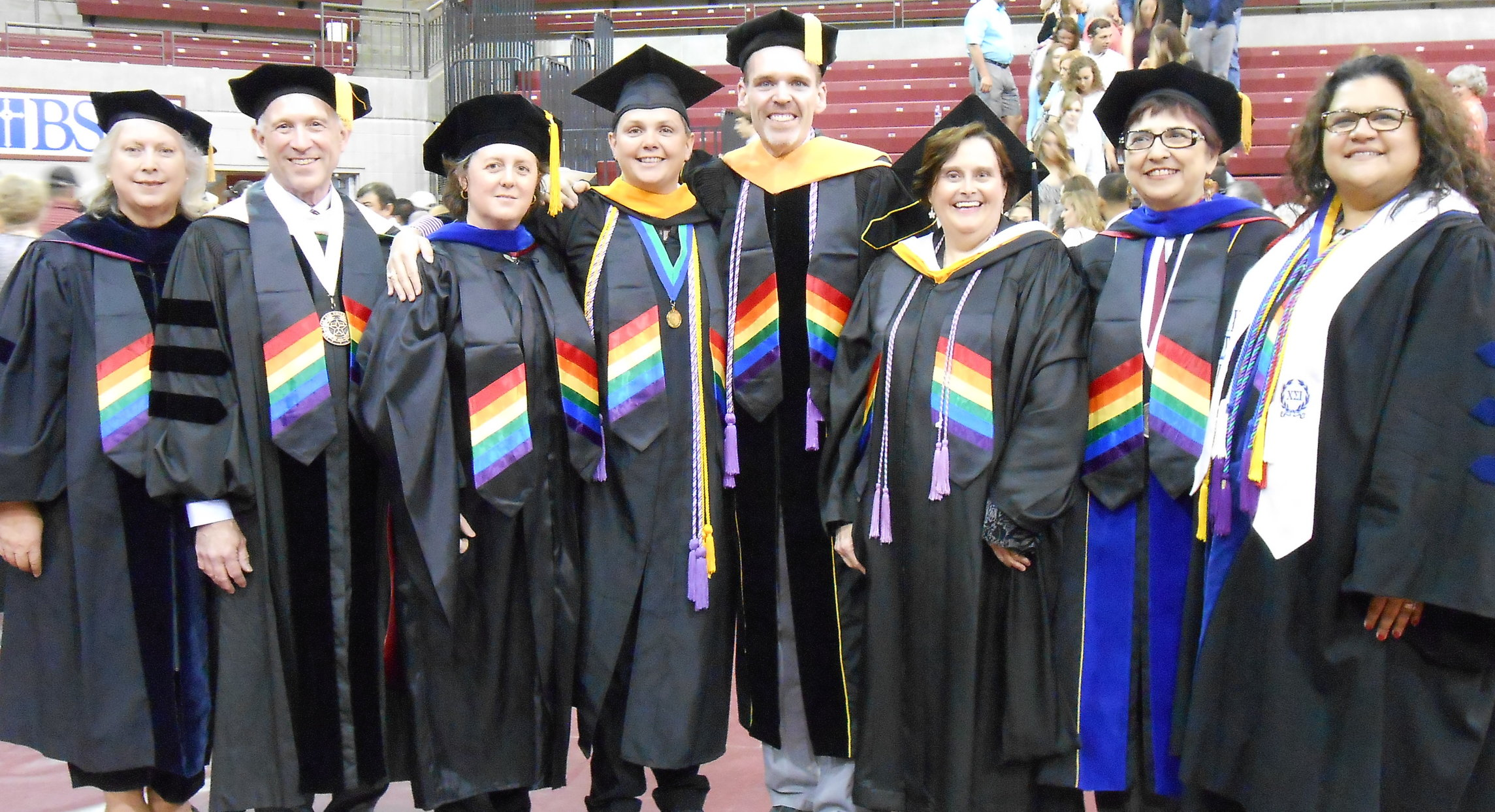 Faculty from Sports Exercise Science, Comm Disorders, and Nursing wearing rainbow stoles. May 2015