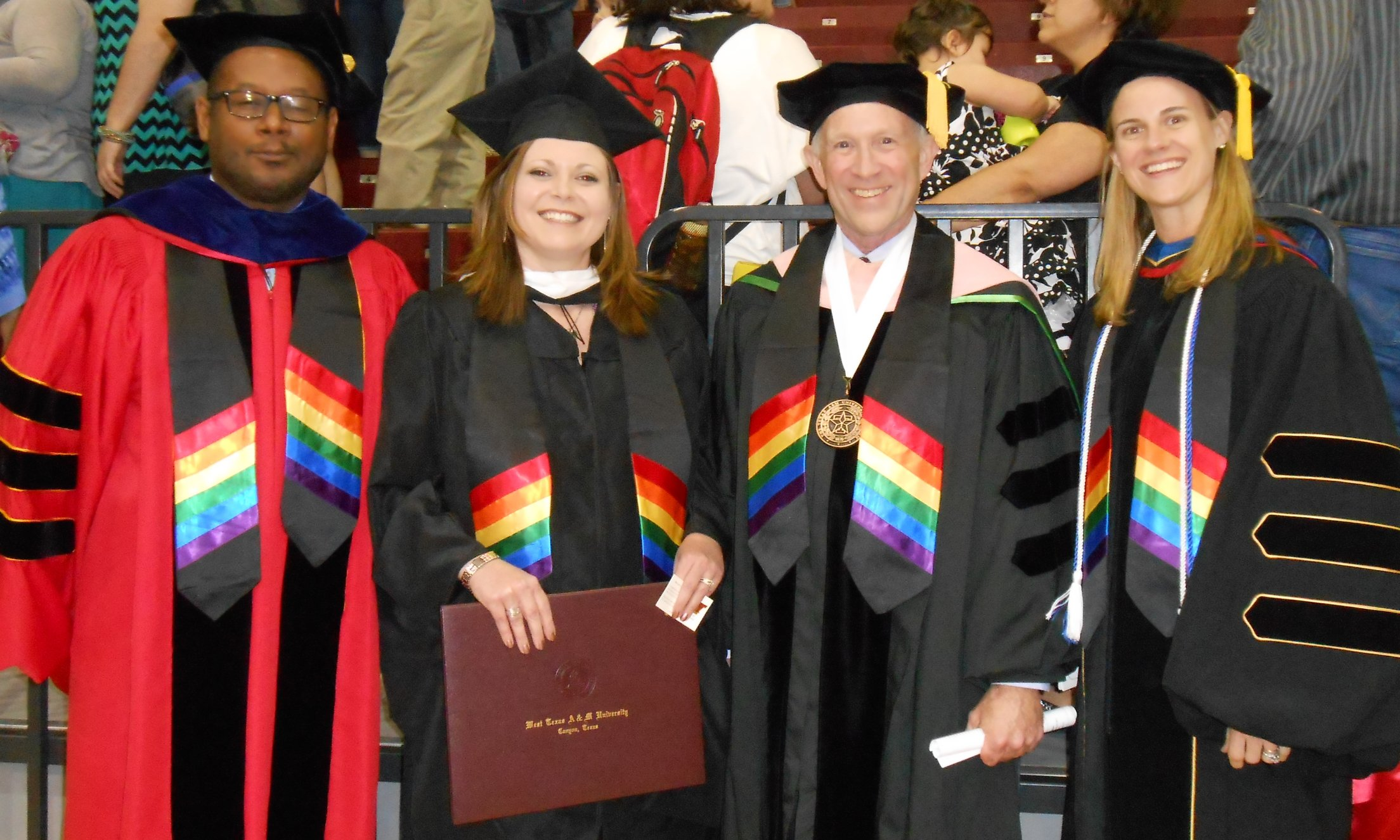 COESS buff allies in rainbow stoles at May 2015 graduation