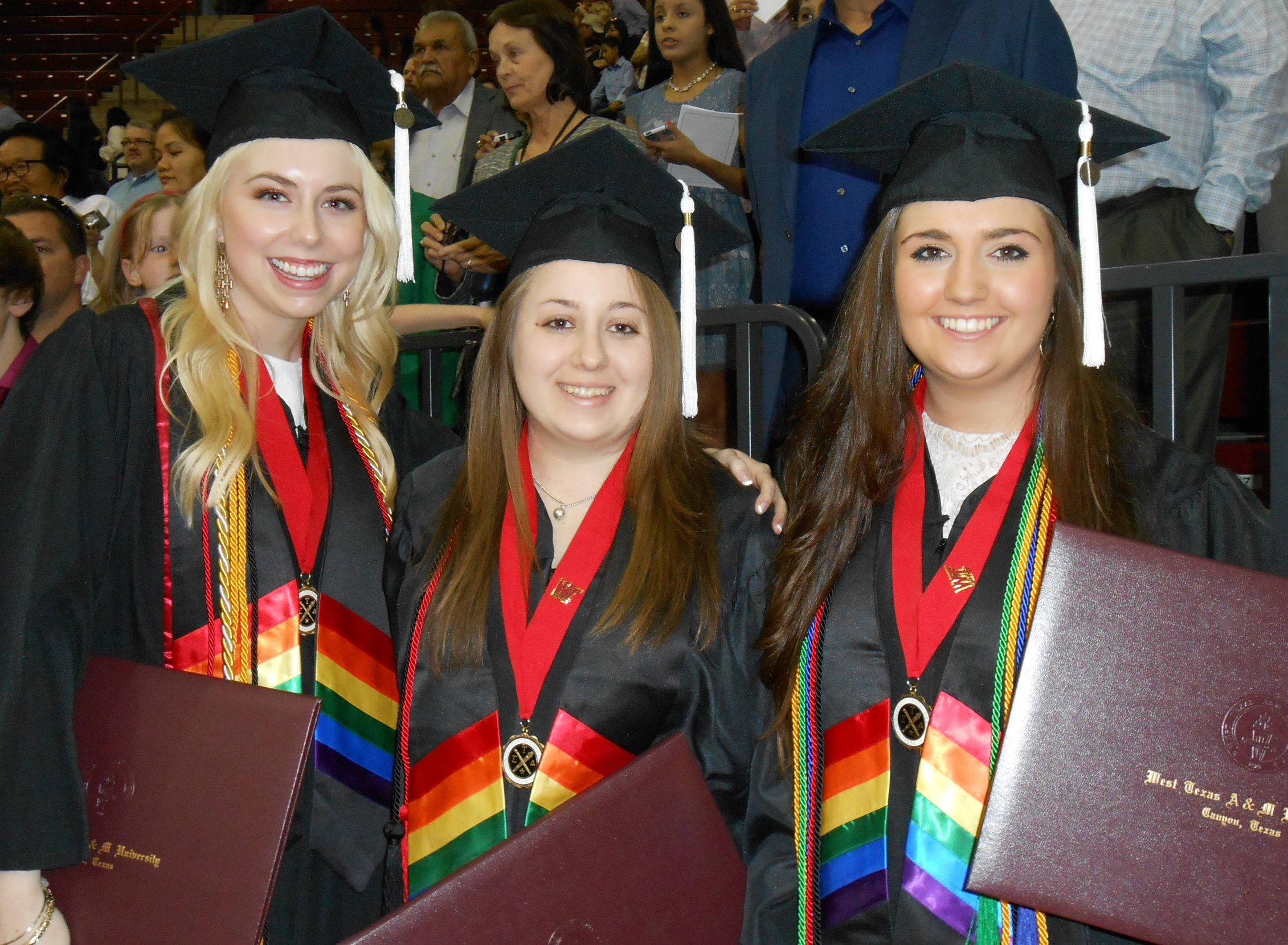 English student graduates wearing rainbow stoles, May 2015