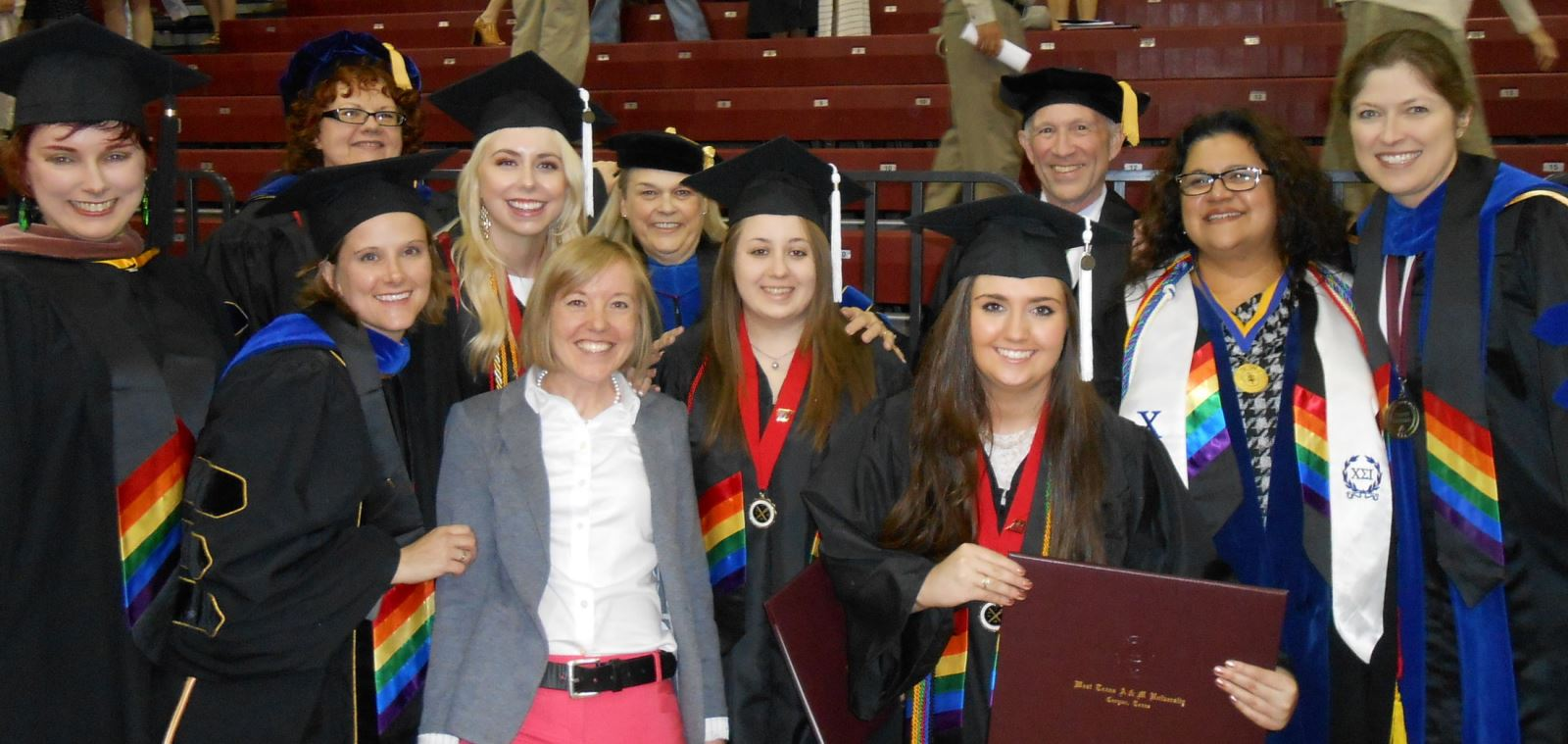 Fine Arts and humanities faculty and students wearing rainbow stoles, May 2015