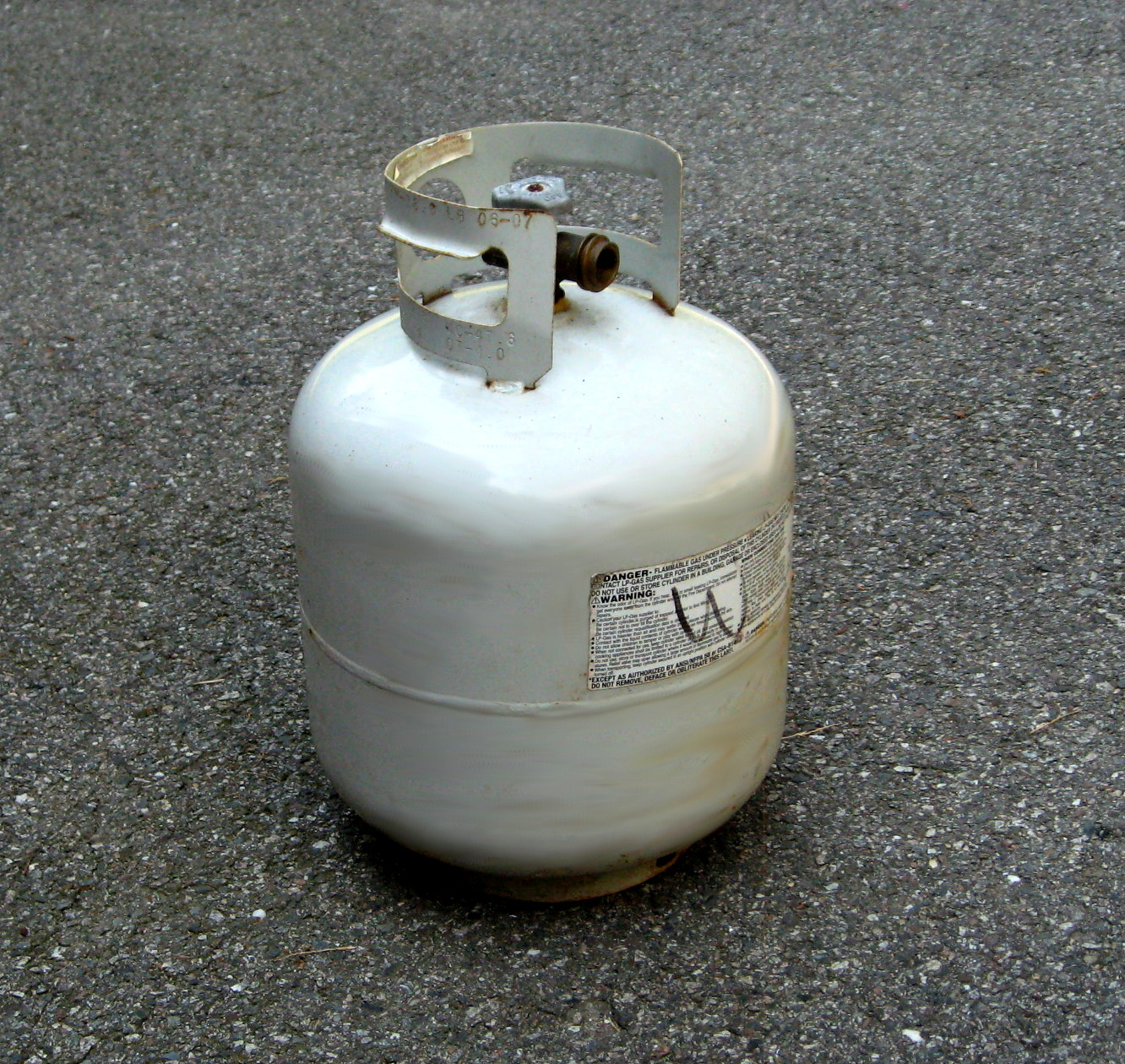 Why is propane stored in household tanks but natural gas is